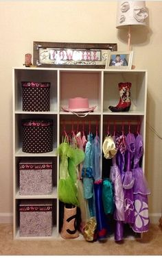 DIY dress up closet Take a 12 cube Closet Maid make several simple modifications & ta-da! Perfect height for your little princess.