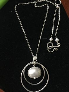 Mother of pearl. She looked kind of lonely so a few hand forged, pure silver hoops were added. Washer Necklace, Pendant Necklace, Silver Hoops, Lonely, How Are You Feeling, Pearls, Jewelry, Design, Silver