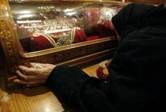 Christian killings doubled in 2013 Trieza ,73, an Egyptian Christian grieves while kissing a glass capsule containing cloth belonging to Christian martyrs in the Coptic Orthod...