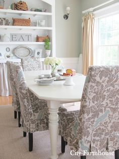 More pics and original blog of a great dining room remake. Would be a great new look for someone looking to re-make 1980s and 90s oak. Love the chair cover fabric. //City Farmhouse: Dining Room Reveal