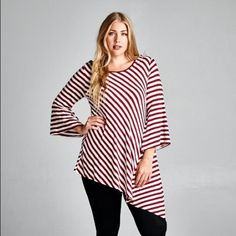 COMING SOON: Asymmetrical Tunic Top This gorgeous, flattering tunic features a fun asymmetric hem and flared sleeves. Burgundy/white diagonal stripe. 95% Rayon / 5% Spandex. Like this listing to be notified of when this shirt will be available!! Boutique Tops Tunics