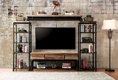 "4 pc Kerbyll collection industrial metal pipe style antique black finish and replicated wood entertainment center. This set includes the TV stand , 2 side piers and top bridge. Measures 104"" W x 15 1/2"" D x 64"" H. Some assembly required."