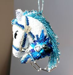 The Blue Poinsettia Christmas Horse Ornament is available on Etsy at Safe Habor Boutique.