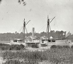 "1864 or 1865. ""Deep Bottom, Virginia. Federal gunboat Mendota on the James River. Put in service May 2, 1864."" From photographs of the Federal Navy and seaborne expeditions against the Atlantic Coast of the Confederacy. Wet plate glass negative, photographer unknown."