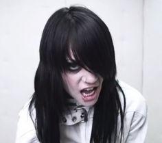 "Rene Phoenix in the ""Damage"" music video."