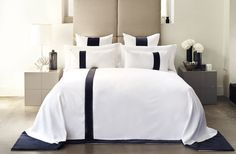 For me the bedroom is absolutely central to your well being and comfort. The bed and the way you dress it should be a priority as nothing can change the mood of the room more. The crisp looking white matelassé cotton of this runner contrasts beautifully with the rich lustre of the dark velvet trim. Simple and fashionable, this bedspread automatically creates a sense of sophisticated natural harmony and calmness in the bedroom.