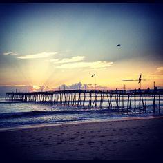 Sunrise at Avalon Fishing Pier in Kill Devil Hills, North Carolina.