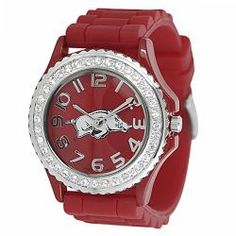 @Overstock.com - This stylish watch shows school spirit by featuring the Arkansas Razorbacks logo on the dial. The soft silicone strap adjusts to fit a variety of wrist sizes, while the buckle clasp ensures your piece will stay securely fastened.http://www.overstock.com/Jewelry-Watches/Geneva-Womens-Platinum-Rhinestone-accented-Arkansas-Razorbacks-Watch/6014620/product.html?CID=214117 $25.99