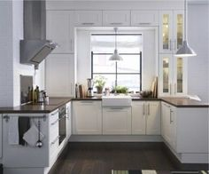White kitchen cabinets, Countertops and Dark granite countertops