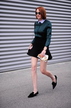 A Skater Skirt, a Long-Sleeve Blouse, and Pointy-Toe Flats: A slightly shorter skirt (one that hits just above the knee) works in casual offices if you're completely covered up top. Finish with pointy-toe flats that elongate your legs.