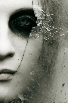 This artistic composition shows the artist's flair for mixing the fragile human face with the decay and danger of the broken glass. Top lit for shadows, monochromatic for mood and perfect placement of the fractures to create a deeper story.