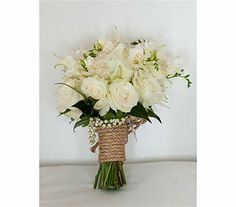 Elegant country wedding.  Classic white bouquet, rich in texture - with combination of pearl and rope wrap.
