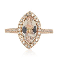 This gorgeous Morganite Engagement Ring showcases nearly 1/2 carat of sparkling…