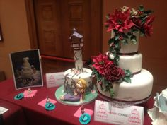 Miniature Dollshouse Fair in Italy had a Contest for MiniCake Designers... next to each full-sized cake is the mirror image in 1:12th scale! ~ Pic 1 of 8