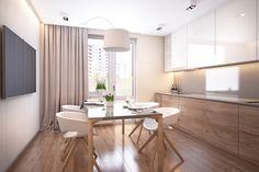cuisine aménagée d'armoires hautes blanches et armoires basses en bois