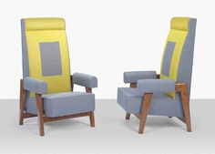 PIERRE JEANNERET (1896-1967)  A PAIR OF ARMCHAIRS, CIRCA 1953  from the High Court, Chandigarh, teak, upholstery  53½ in. (135.8 cm.) high (2)