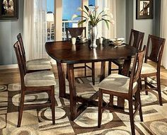 Love this rug design idea for this dining table color.