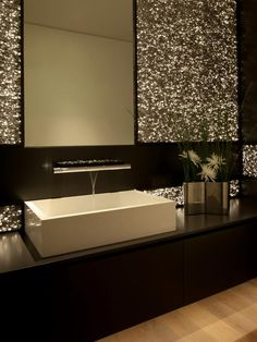 Love the sink in this dramatic bathroom with metallic wall  HGTV.com.