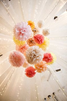 Says: I am a huge fan of Tissue Poms. They are inexpensive, easy to make,  and they are just so stinking cute. The combination of the Sporadic  Colorful Tissue Poms with the String Lights makes for a Lovely  Combination.