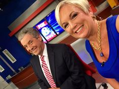 FOX8's Brad Jones and Cindy Farmer commemorate Memorial Day wearing red, white and blue.