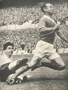 Maurice Norman tackles Stanley Matthews