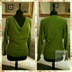 evie. Cowl neck sweater Beautiful green sweater! Size lg has a large ribbed band at bottom and on sleeves for fitting. Not a tight sweater but not baggy either, its very flattering. Upper part of sleeves are wider giving the effect of the batwing style, but are not as wide, gives you room around your shoulders and underarms. there is a tiny whiteish spot on the inner/underside of the right sleeve but barely visible. I've included a picture.  No snags, or pilling *** evie Sweaters Cowl…