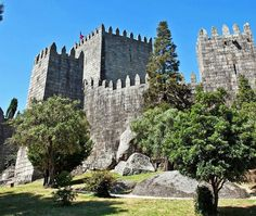 Guimaraes Castle, the most famous castle in Portugal as it was the birth place of the first Portuguese King and the Portuguese nation Portugal Travel, Spain And Portugal, Lisbon Portugal, Portugal Trip, The Places Youll Go, Places To Go, Day Trips From Lisbon, Famous Castles, Holiday Places
