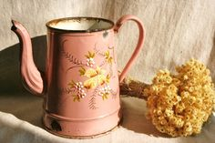 French enamelware pitcher, antique coffee pot, French country kitchen, hand painted, French country decor, rustic kitchen, pink and yellow. $78.00, via Etsy.