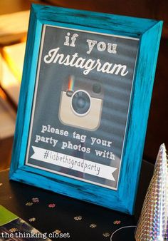 Set out a sign with your party hashtag to easily look at everyone's photos later. | 31 Grad Party Ideas You'll Want To Steal Immediately