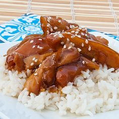 Honey Bourbon Crock Pot Chicken	    1 lb. boneless, skinless chicken thighs  salt and pepper  1/2 cup diced onion  1 cup of honey  1/2 cup low sodium soy sauce  1/4 cup ketchup  2 Tbsp. canola oil  2 cloves of garlic, minced  1/4 tsp. red pepper flakes  1-2 Tbsp cornstarch  hot rice  sesame seeds, optional
