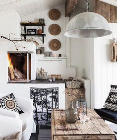 Look at these pillows and carpet on the wall with a little outdated motifs. Black and white combination is evergreen in almost every aspect, so that the rustic interior designers often opt for this combination. If there was no fireplaces whole area would have seemed somewhat cold and uncomfortable but fireplace is there what radically change the impression.