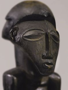 BUYU MALE ANCESTOR FIGURE, DEMOCRATIC REPUBLIC OF THE CONGO Height: 17 1/4 in (43.8 cm) Sotheby's New york In Pursuit of Beauty: The Myron Kunin Collection of African Art 11 November 2014