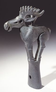 A bronze finial in the shape of an elk made of pierced bronze. Inner Mongolia, 6th-5th Century BC, Height: 6.87 inches, Ordos Type