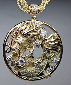 """This is the pendant finished in 18K with several diamonds. It is 2"""" in diameter."""