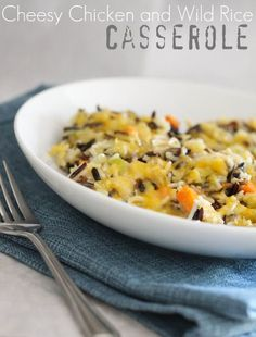 Cheesy Chicken and Wild Rice Casserole 3 Tablespoons extra virgin olive oil 1 medium onion, finely diced 3 stalks celery, finely diced 3 carrots, peeled and diced 2 Tablespoons fresh minced garlic 2 Cups shredded, cooked chicken breast 2 Cups steamed white rice 16 oz prepared wild rice (I get mine at Trader Joes, LOVE …