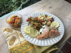 Marinated, grilled salmon, Greek green beans and orzo salad with a Caprese salad give the gift of food an international twist.