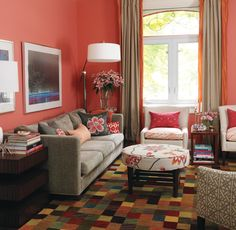 Love the colour of the walls, accompanying pillows in similar shades and the round table :)
