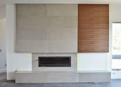 MODE CONCRETE: Contemporary Concrete Fireplace with Flush Wood Grain Cabinetry - Concrete Large Format Tiles created by MODE CONCRETE