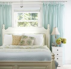Bed in front of window . . . I really love the large curtains which make the window look bigger and balance a headboard as well. that is the same size as my winow this is perfect for the room :
