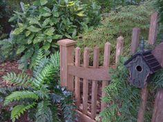 Bird House on Fence