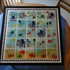 Tiles could be framed easily. Love the ocean theme