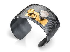 Signature Cuff by Lori Gottlieb: Gold, Silver & Stone Bracelet available at www.artfulhome.com Oxidized silver cuff with embossed texture accented by 22k bimetal and a 12 mm trillion-cut white drusy.