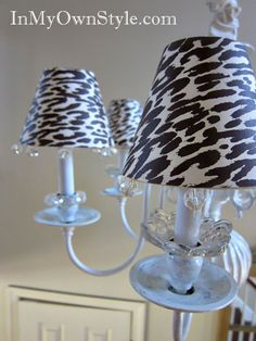 "DIY covers to disguise the shades for the ""builder grade"" chandelier. I might not choose animal prints, but what a SUPER idea! I recently priced the little lampshades and could not believe my eyes!"