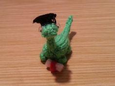 Hand Knitted Graduation Miniature Dinosaur £6.00