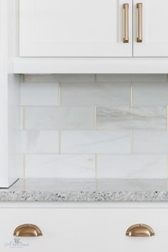 Kitchen backsplash is honed marble by the Tile Shop with brass schluter strips. Kitchen backsplash is honed marble by the Tile Shop with brass schluter strips. Kitchen Redo, Kitchen Tiles, New Kitchen, Brass Kitchen, Kitchen Cabinets, White Cabinets, Kitchen Cupboard, Kitchen Backplash, Cupboard Ideas