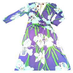 "Lilly P Classic. The perfect ""Go Anywhere"" dress Lilly P does not let us girls down.. ever!  True Lilly P fashion is the clean cut, classic, no nonsense dress, in Colbolt blue and greens.   3/4 sleeves, Big flower tropical print, ruching on left.  Pair with a chunky tote and feel fab!!!! Lilly Pulitzer Dresses Midi"