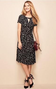 A playful black and white dot cluster dress perfect for cooler weather.