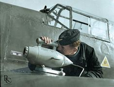 A Luftwaffe's ground crewman installs an Ikon Zeiss ESK 2000 B aircraft camera on the wing of a Messerschmitt Bf 109. The photo is undated and it can be either pre-war or war period given that outdated aircraft were often used by training units.