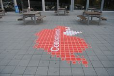 Outdoor floor graphic at a Swiss University.  The graphic was created by printing onto our product, Asphalt Art.