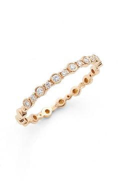Swooning over this rose gold ring that is perfect for stacking. Radiant diamonds add timeless elegance to this Nordstrom Anniversary Sale beauty.